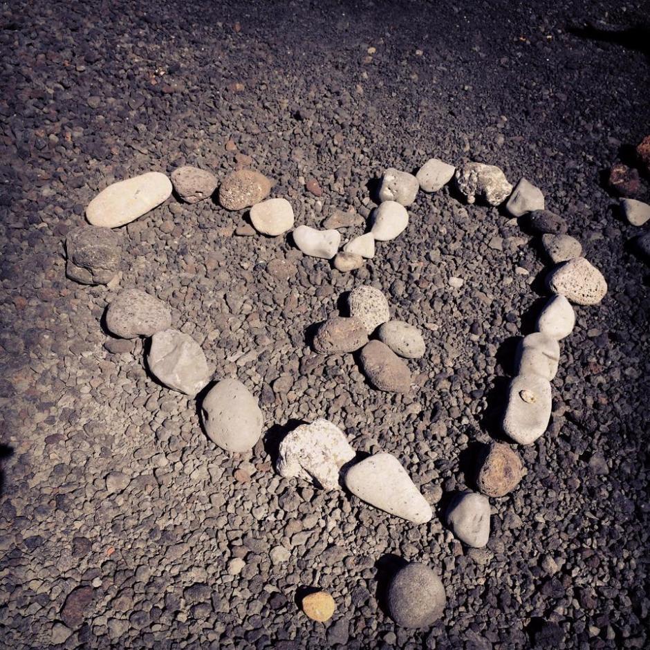 stone heart shape on beach
